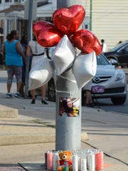 A makeshift memorial for Elizabeth Grisel Vega-Tirado was created at the corner of South Belvidere Avenue and West Princess Street Wednesday, June 28, 2017. She died Tuesday after she was shot outside a store on the street where she lived. Bill Kalina photo