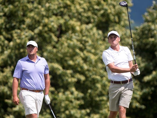 Max Major, left, looks on as Drake Hull hits his tee shot on the first hole during the final round of the 2018 Vermont Amateur at the Country Club of Vermont on Thursday in Waterbury.