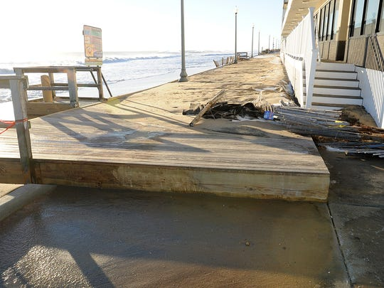 After three consecutive high tides, the dune at the north end of Rehoboth Beach is gone Sunday morning. Waves rushed under the structure and bucked it. Thick sand coated the surface.
