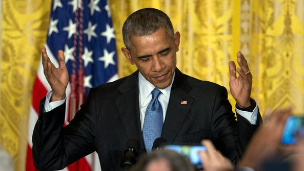 President Obama gestures as he arrives to speak to