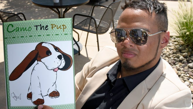 "Local author Levi Walter, of Scotland, is the author of a new children's book, ""Camo the Pup."" The book was written to help children deal with difficult times in life."