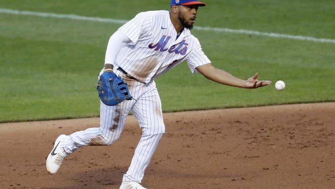 New York Mets first baseman Dominic Smith throws to first for an out during an instrasquad baseball game at Citi Field on Thursday, July 16, in New York.