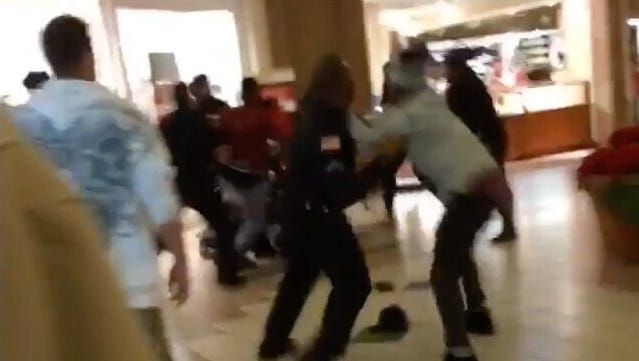 Three fights at a Greece mall resulted in five people being charged by Greece police.