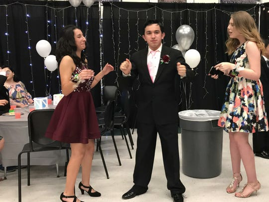 King High School students dance during the Mighty Mustangs Prom on Friday, May 18, 2018, at King High School.