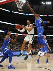 Miles Bridges #22 of the Michigan State Spartans drives