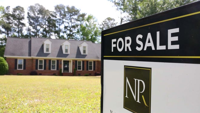 """A Nathan Perry Realty, LLC """"for sale"""" sign sits outside a home on Fox Run Circle in the Detas Fields neighborhood in Lenoir County."""