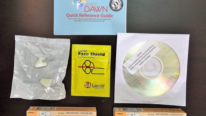 Each Project Dawn nasal naloxone kit contains an applicator, two doses of the medication, an atomizer that turns the liquid into a spray and a face mask.