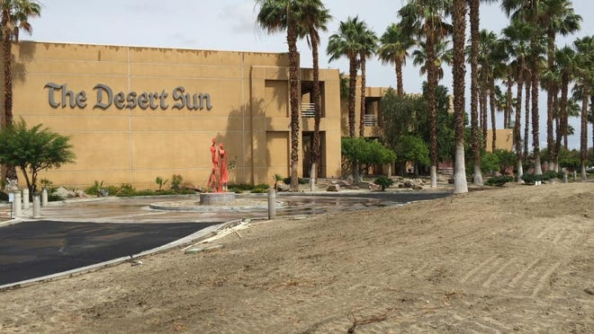 During the first week of desert scaping work, The Desert Sun's building at 750 N. Gene Autry Trail had a large potion of its front turf removed.