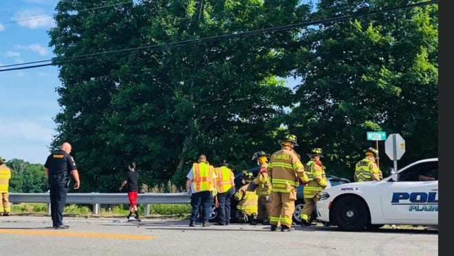 Plainfield firefighters and other first responders at the scene of a two-car crash on Canterbury Road in June.