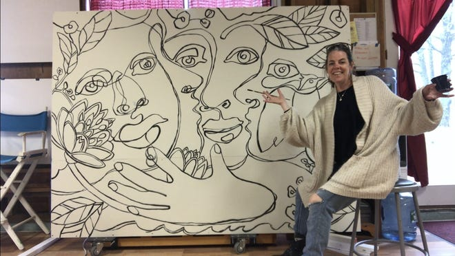 Artist Jackie Reeves displays the mural she has created that will become a community art project at Cotuit Center for the Arts.