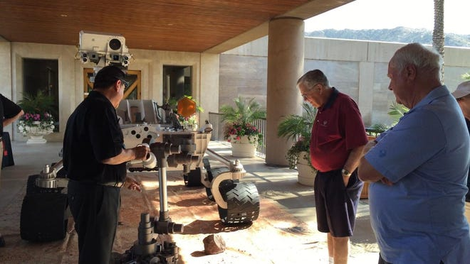Vintage Club members inspect a duplicate of the Mars rover that visited the Indian Wells Country Club Thursday as part of a presentation for members by Caltech officials.