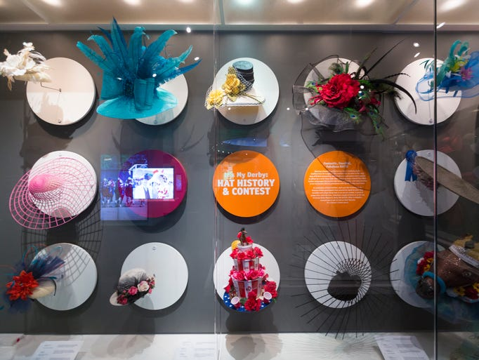 An exhibit of hats from people who attended the 2016