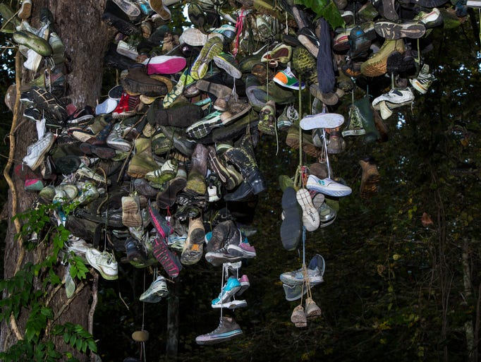 Hundreds of shoes dangle from the Milltown Ind. shoe