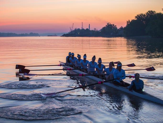 Members of the U of L rowing team make their way east