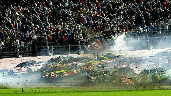 Austin Dillon (3) goes airborne into the catch fence during the finish of the 2015 Coke Zero 400 at Daytona International Speedway.