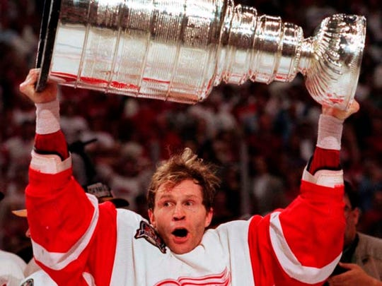 Vladimir Konstantinov takes his turn with the Stanley Cup after the Red Wings' victory against the Flyers in Game 4 on June 7, 1997.