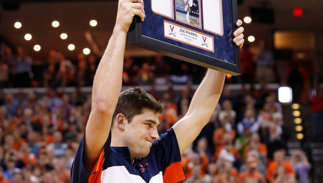 Virginia Cavaliers guard Joe Harris holds a plaque during Senior Day ceremonies prior to the Cavaliers game against the Syracuse Orange at John Paul Jones Arena. The Cavaliers won 75-56 and clinched the ACC regular season title.