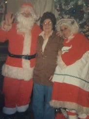 Michael and Cheryl Naniot dressed and Santa Claus and