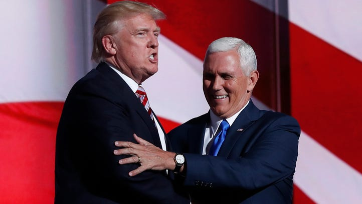 Republican Presidential Candidate Donald Trump greets Republican Vice Presidential Nominee Gov. Mike Pence of Indiana during the third day session of the Republican National Convention in Cleveland, Wednesday, July 20, 2016.