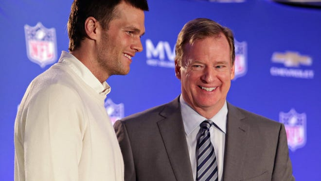 In this Feb. 2, 2015, file photo, Patriots quarterback Tom Brady, left, poses with NFL Commissioner Roger Goodell during a news conference where Goodell presented Brady with the MVP award from NFL Super Bowl XLIX .