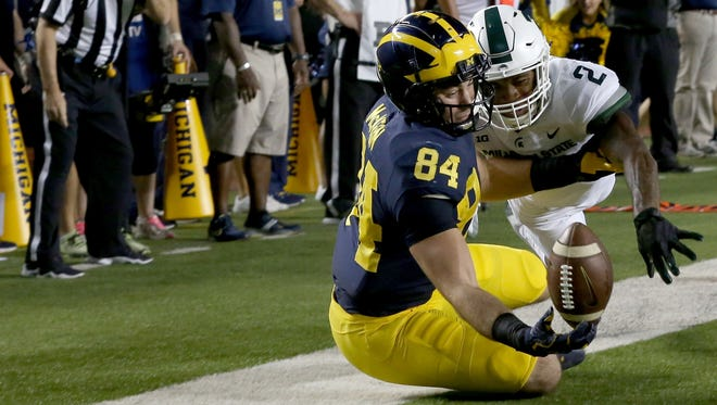 Michigan #84 Sean McKeon can't come up with the catch in the end zone as Michigan State #2 Justin Layne defends during first half action between MSU and U-M at Michigan Stadium in Ann Arbor on Sat., Oct. 7, 2017.