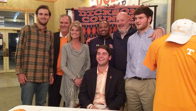 Dickson County High's Hunter Wolcott recently signed with the University of Tennessee's golf program. He's pictured with family and coaches.