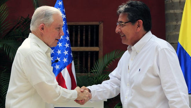 Attorney General Jeff Sessions greets the Attorney General of Colombia, Nestor Humberto Martinez, at the end of the Trilateral Summit against Transnational Organized Crime, between Colombia, Mexico and the United States, in Cartagena, Colombia, Dec. 7, 2017.