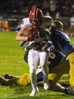 CVU's Brad Reynolds, left, runs for a touchdown against Essex in Essex Junction on Friday, September 23, 2016.