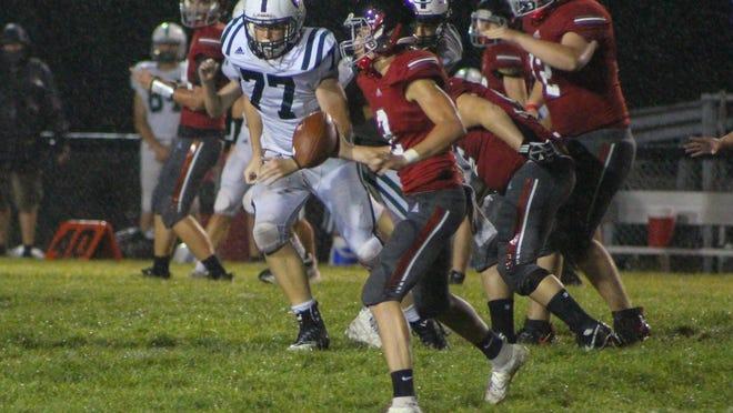 Springfield junior quarterback Michael Fuller rolls out during Friday's season opener against Cloverleaf.