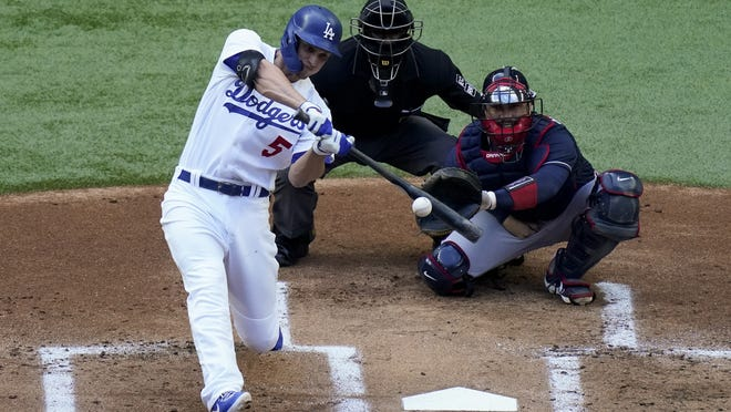 Los Angeles's Corey Seager watches his home run against the Atlanta Braves during the first inning of Saturday's game.