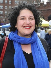 Corinna Makris, the market manager at the Scarsdale's farmers market, is pictured at the village green, April 12, 2018.