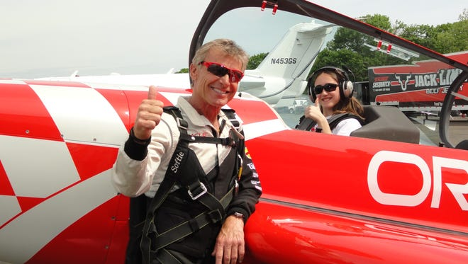 Gianna Pellechia, 13, of Commack, N.Y., takes a Young Eagles flight with Sean Tucker before the Bethpage Air Show in May.