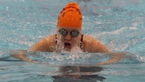 Maya Carragher swims the breaststroke leg of the 200 IM.  Staff file photo/Mark R. Sullivan