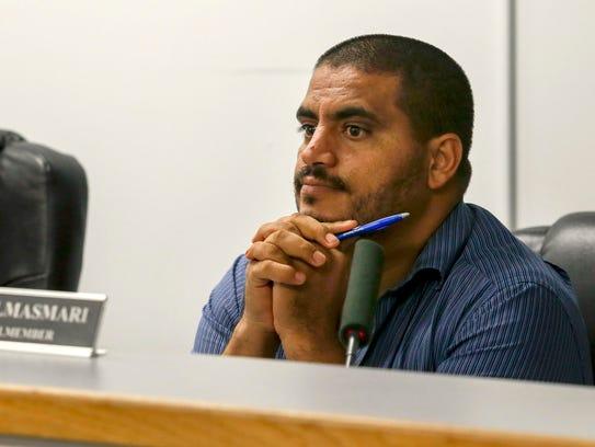 Councilman Saad Almasmari listens to a comunity member