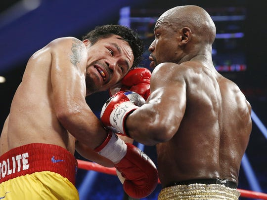 Manny Pacquiao, left, trades punches with Floyd Mayweather Jr. during their welterweight title fight May 2 in Las Vegas.