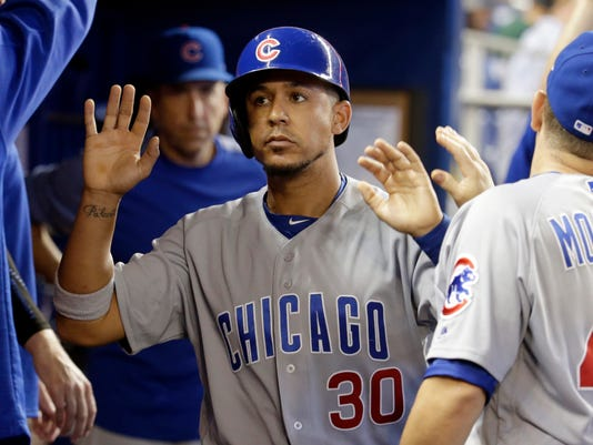 Chicago Cubs' Jon Jay (30) is congratulated after scoring on a single hit by Ian Happ during the first inning of a baseball game against the Miami Marlins, Saturday, June 24, 2017, in Miami. (AP Photo/Lynne Sladky)