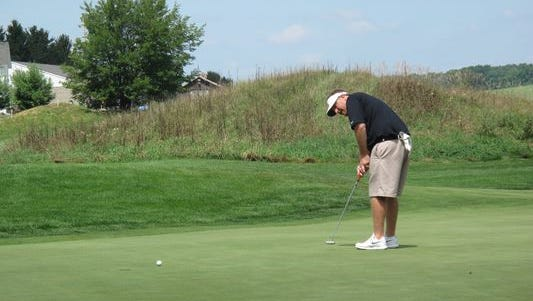 Mike Fisher putts at The Links at Union Vale last year. He is the defending Dutchess County Amateur champion.