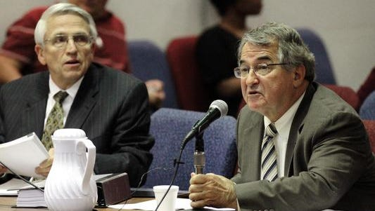 Former Lafayette Parish superintendent Pat Cooper, right, is seen with his attorney, Lane Roy, during termination hearings in November 2014.