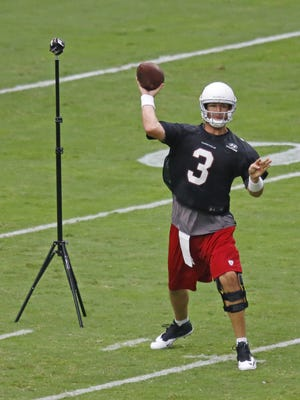 Arizona Cardinals quarterback Carson Palmer makes a picture perfect throw during training camp Saturday, August 1, 2015 in Glendale, Ariz.