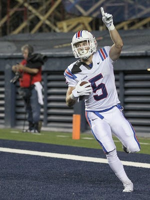 Oct 30, 2015; Houston, TX, USA;  Louisiana Tech Bulldogs wide receiver Trent Taylor (5) celebrates after scoring a touchdown against the Rice Owls in the first quarter at Rice Stadium. Mandatory Credit: Thomas B. Shea-USA TODAY Sports