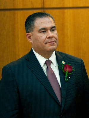 In this Jan. 20, 2015, file photo, State Democratic Sen. Michael Padilla stands at the New Mexico state capitol in Santa Fe, N.M. New Mexico Democratic gubernatorial candidate Michelle Lujan Grisham says Padilla should leave his race for lieutenant governor over claims he harassed women as a city of Albuquerque supervisor.
