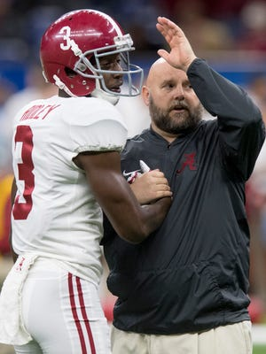 Alabama offensive coordinator Brian Daboll talks with wide receiver Calvin Ridley (3) before the Sugar Bowl at the Superdome in New Orleans, La. on Monday January 1, 2018. (Mickey Welsh / Montgomery Advertiser)