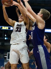 Bowie's Daniel Mosley (33) battles for the round with Mount Vernon's Kason Pletcher (3) during a UIL Class 3A boys high school state championship basketball game at the Alamodome in San Antonio, Friday, March 9, 2018. (Stephen Spillman)
