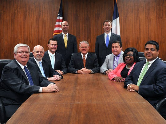 Wichita Falls City Council. Mayor Glenn Barham, back center, will be replaced Nov. 22 when Stephen Santellana, right front, will be sworn in as the new mayor.