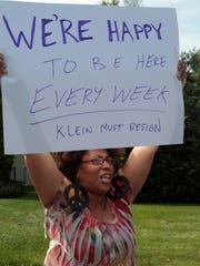 Beverly Watson of Airmont protests in front of East