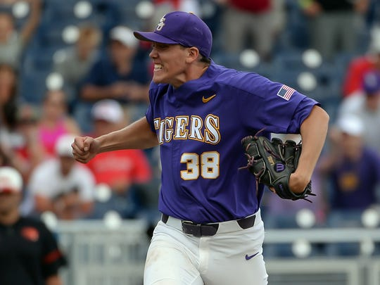 Jun 23, 2017; Omaha, NE, USA; LSU Tigers pitcher Zack Hess (38) celebrates the win against the Oregon State Beavers at TD Ameritrade Park Omaha. Mandatory Credit: Steven Branscombe-USA TODAY Sports