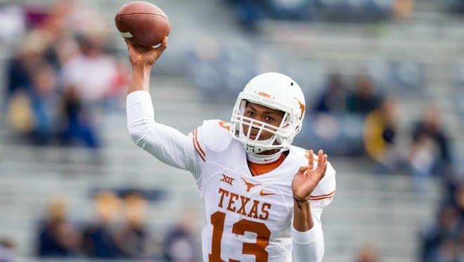 Texas Longhorns quarterback Jerrod Heard warms up before their game against the West Virginia Mountaineers at Milan Puskar Stadium.