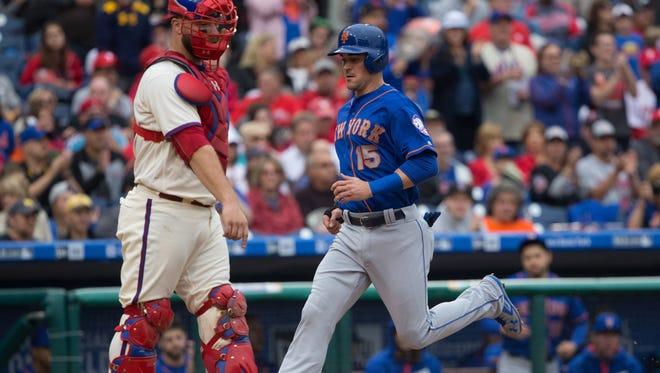 New York Mets shortstop Matt Reynolds (15) scores a run past Philadelphia Phillies catcher Cameron Rupp (29) during the sixth inning of Sunday's game at Citizens Bank Park.