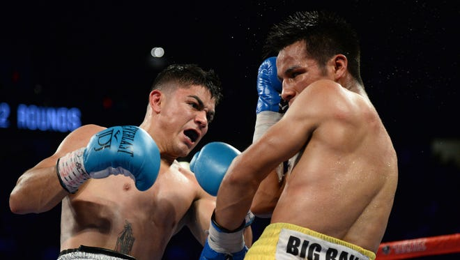 Joseph Diaz, left, lands a punch on Rafael Rivera, right, during their bout at T-Mobile Arena in Las Vegas.