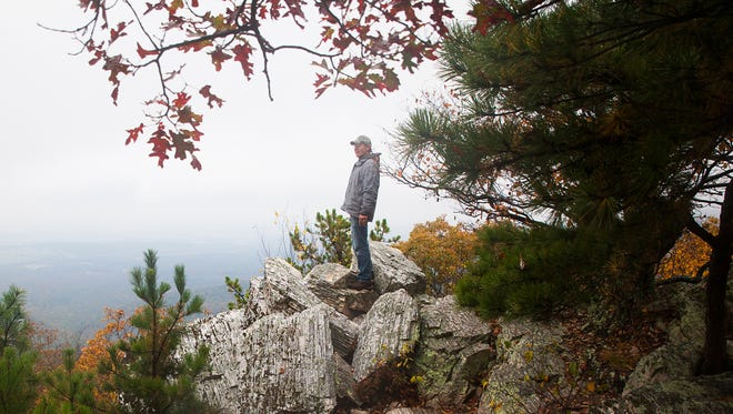 Michael Pagan, of Nevada City, Calif., looks out from atop Calvary Rocks after hiking along Riprap trail in the Shenandoah National Park on Sunday, Oct. 12, 2014.